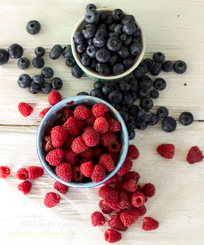 Fresh, sweet BC raspberries & blueberries at the height of the season. On weathered white boards.