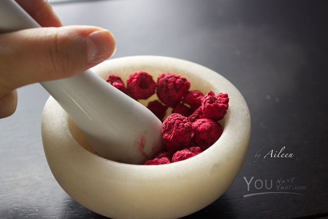 Aileen grinding freeze-dried raspberries for macarons with mortar and pestle