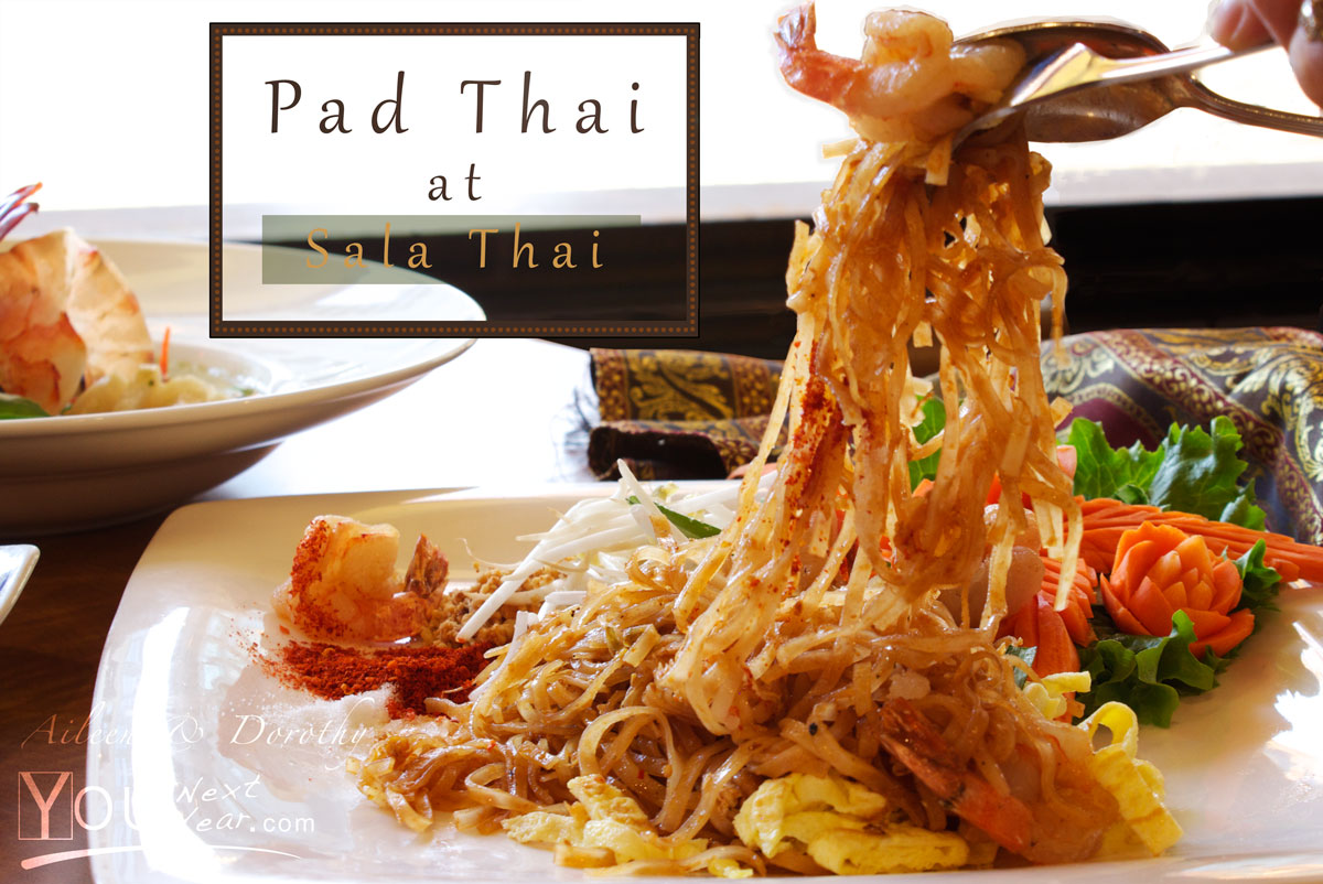 Pad Thai at SalaThai restaurant in Vancouver. Noodles being lifted from serving dish. Carved carrot-flower garnish
