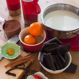 Ingredients for Mexican spiced hot chocolate: Chocolate, cocoa, vanilla pod, cinnamon sticks, orange zes, red chili & pot of whole milk