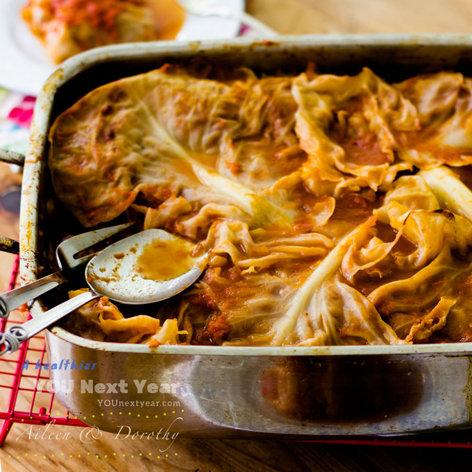 Cabbage rolls straight from the oven, covered with outer leaves to keep them full of juicy goodness.