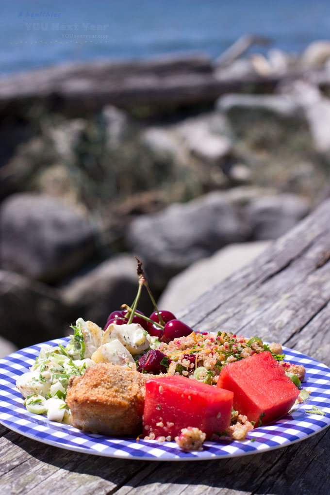 First picnic of the year beside the rocky ocean shore! Quinoa salad, potato salad, baked chicken, watermelon and cherries.