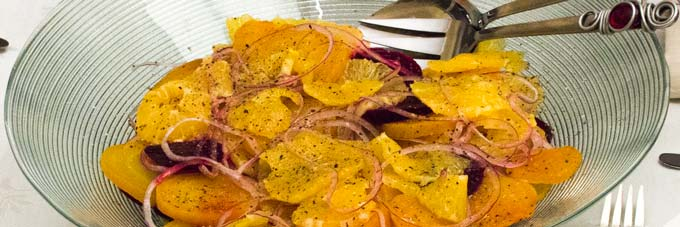 Sliced Oranges layered with roasted Golden & Ruby Beets and thinly sliced Red Onion Salad. Drizzled with citrus, sherry vinegar and avocado oil dressing