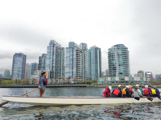 dragon boat practice, dragon boat team, on the water, city towers in the background, false creek vancouver