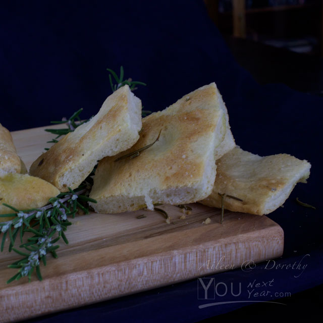 Rosemary Truffle-Salt Focaccia squares on wooden board, with rosemary