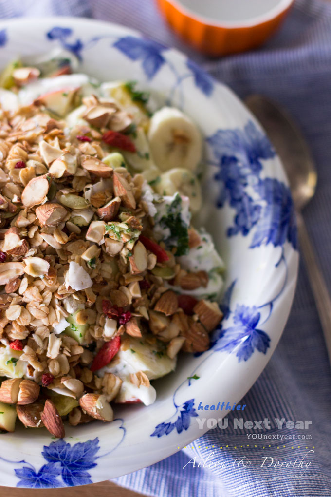 Apple, orange, minced kale & bananas with plain yogurt. Topped with Aileen's granola and toasted almonds.