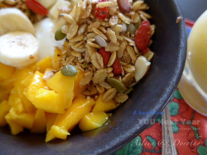 Buttery mango in season, bananas and plain yogurt with homemade granola