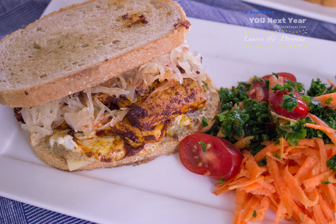 Vegetarian Reuben with marinated tofu, German-inspired sauerkraut, Swiss cheese, vegan mayo, sweet Dijon mustard on grilled rye bread. --With shredded carrot, minced kale and baby tomato side. Served with a soft pretzel and cold Ontario beer.