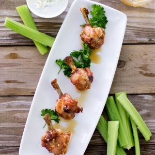 Crispy Baked Chicken Wings dipped in Honey Garlic Sauce. Served alongside Celery Sticks and Blue Cheese Dip.