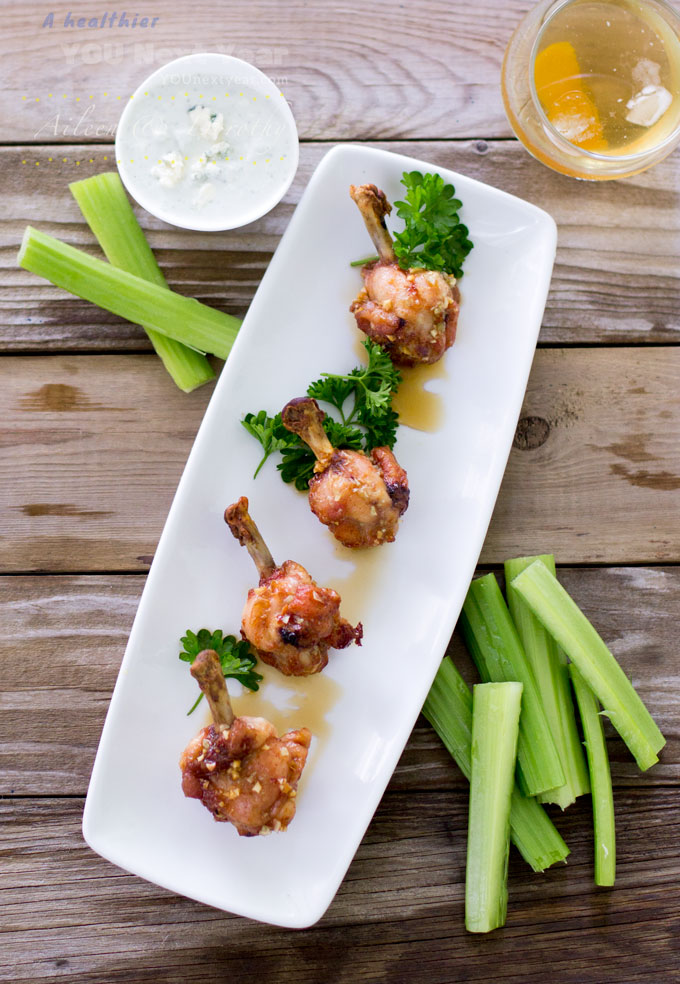 Crispy Baked Chicken Wings dipped in Honey Garlic Sauce. Served alongside Celery Sticks and Blue Cheese Dip..