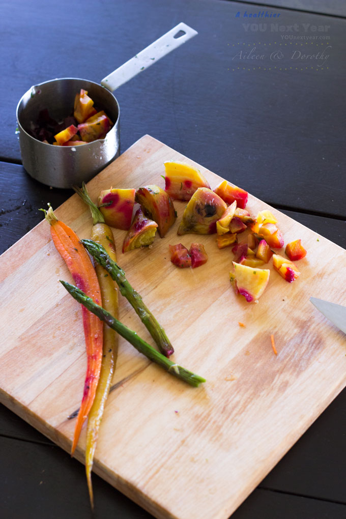 Roasted beets, carrots and asparagus add depth and sweetness, but go ahead and substitute these veggies with what you have on hand. Veggies on chopping board with knife and measuring cup.