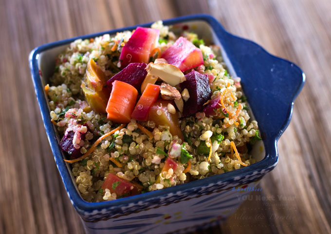 Quinoa salad topped with roasted red and golden beets, orange and yellow carrots that were left over from Aileen's Father's Day dinner.