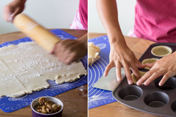 Aileen rolls out pastry with a rolling pin; then cuts pastry rounds and places pastry rounds into muffin tin cups.