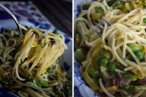 Big forkfuls of al dente spaghetti, studded with peas and edamame, tossed with parmesan, bacon and zucchini bits. Two closeup views of loaded forkfuls.