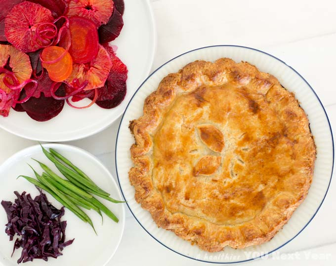 flaky tourtière and a big slice with green beans tossed in olive oil, spiced red cabbage pickle, and salad with orange, beet and thinly sliced onion