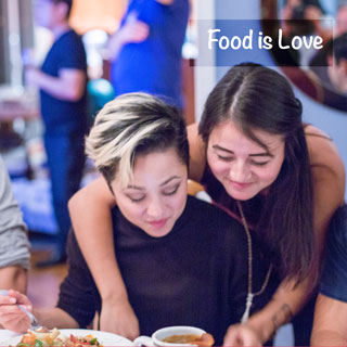 Food is love! Family dinners are so much fun - big energetic, noisy affairs. Everyone brings a special dish or two or three. Such a blessing. Not sure what our daughters are doing here but I love the way they interact. A couple of the guys in the background are catching the dying minutes of an NHL championship game. You Next Year